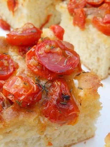 squares of roasted tomato focaccia bread on a white plate