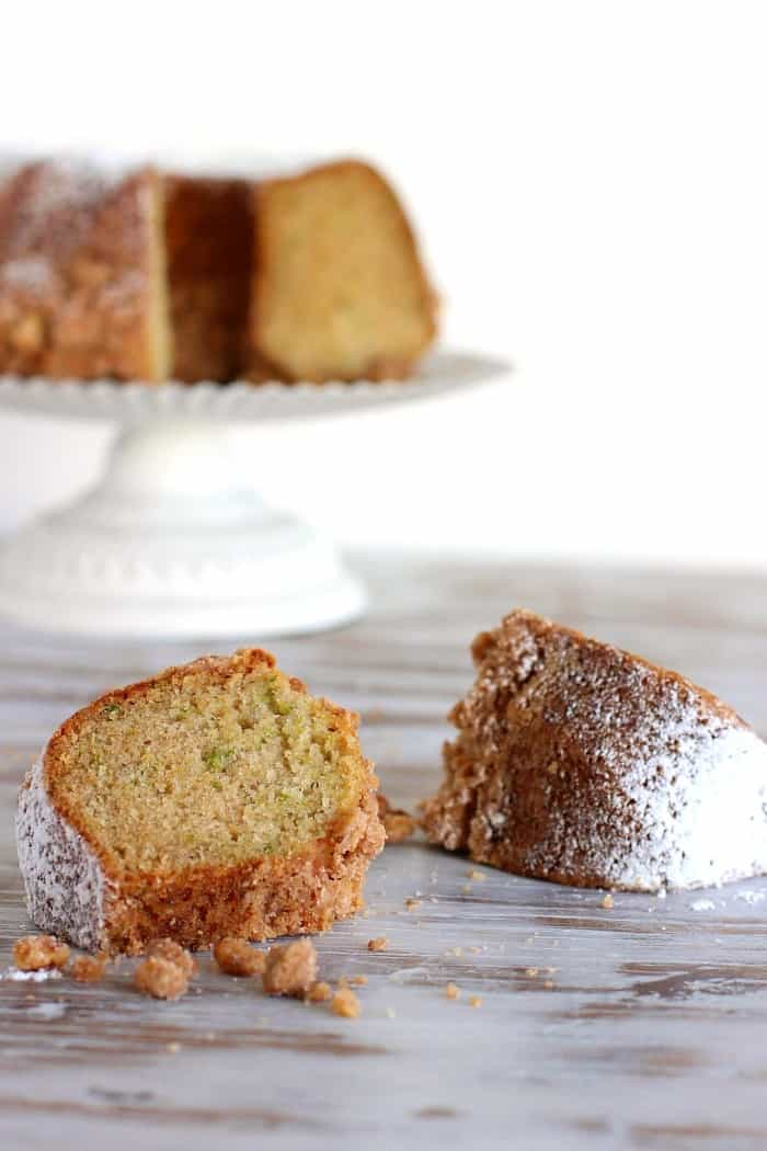 Bundt Cake in white cake stand and two slices on the table
