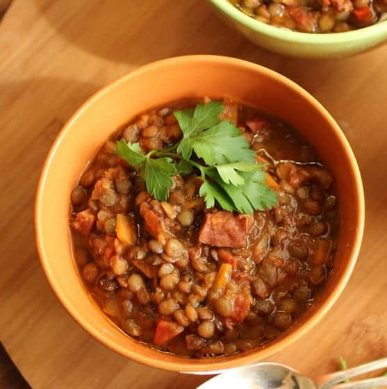 Orange bowl with serving of Lentil and Chorizo Stew