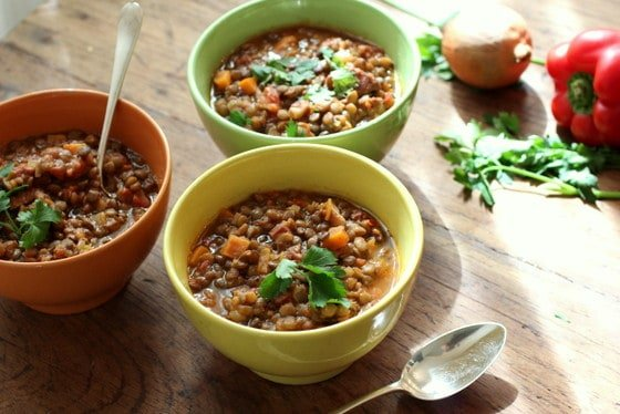 Three colored bowls of Lentil and Chorizo Stew