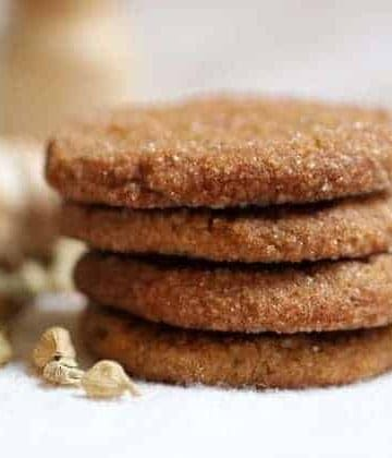 Stack of ginger cookies on light background
