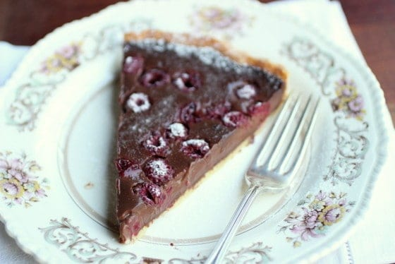slice of Chocolate Raspberry Tart on plate with fork