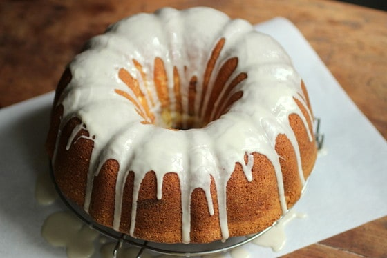 Whole glazed bundt cake on a piece of white paper