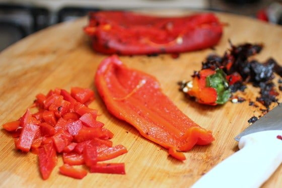 Wooden board with cut red pepper