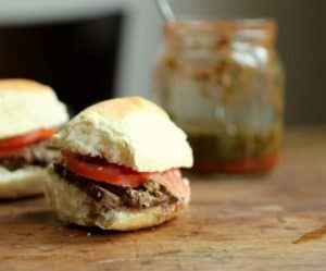 Marinated Steak and Chimichurri Sliders, wooden table, jar in the back