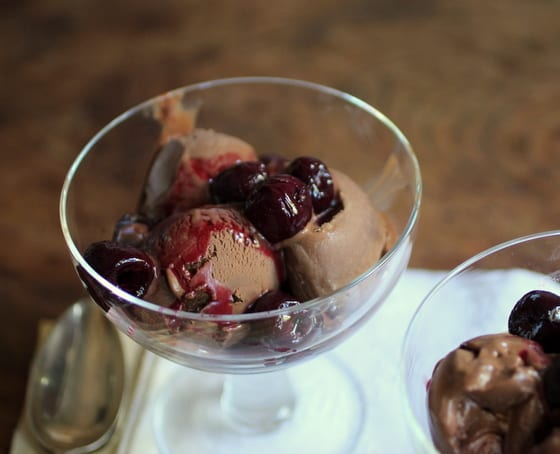 Top view of cherry sauce with chocolate ice cream in glass bowl