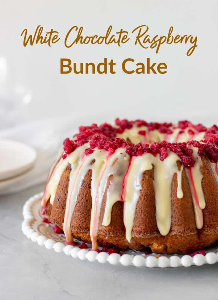 Glazed white chocolate raspberry bundt cake on white plate, grey background, with text