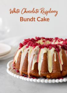 Glazed white chocolate raspberry bundt cake on white plate, grey background, with text