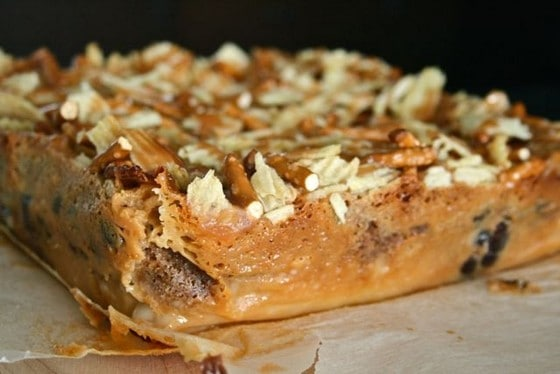 Square of sweet bars topped with potato chips and pretzels