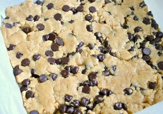 Unbaked square of cookie dough with chocolate chips