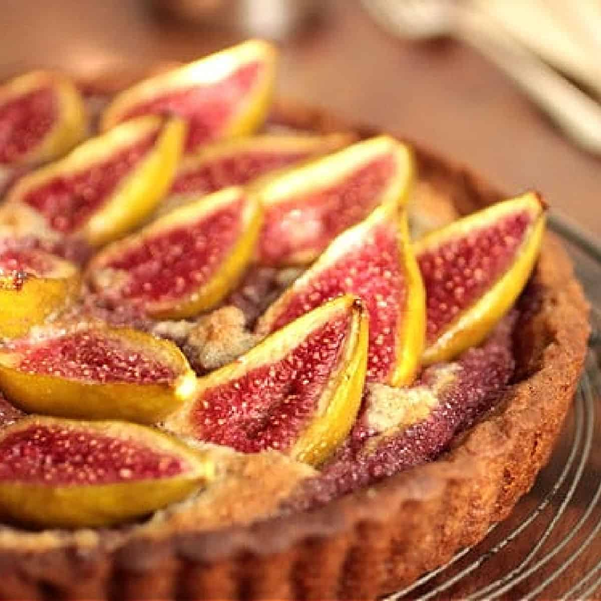 Partial view of fresh fig tart on wooden table