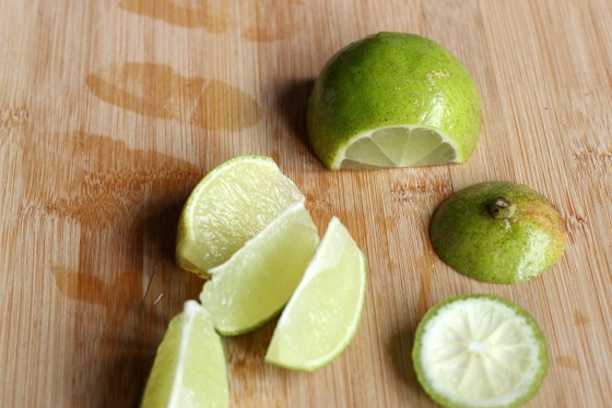 Lime wedges for Cherry Caipiroska on wooden board