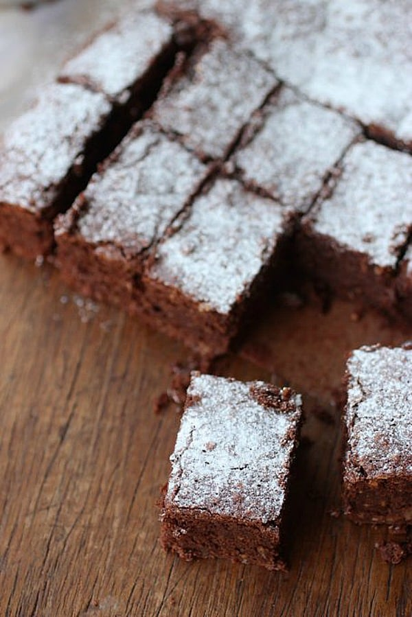 Overview of hazelnut brownies squares on wooden table