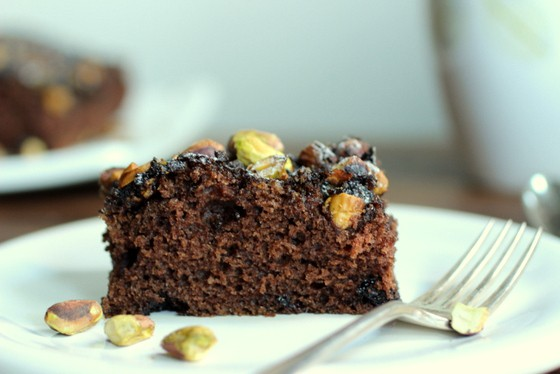 Single square of Chocolate Pistachio Coffee Cake on white plate, a silver fork