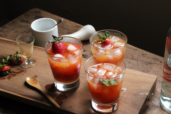 Strawberry and Passion Fruit Caipirinha glasses, wooden table, props