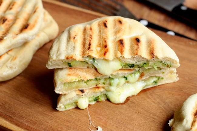 Stack of Mozzarella and Pesto Grilled Naan Bread on wooden board