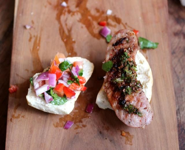 Open Chorizo, Chimichurri and Salsa Sandwich on wooden board