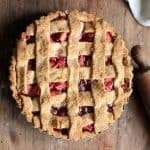 Whole Raspberry Apple Crostata Pie on wooden table, rolling pin