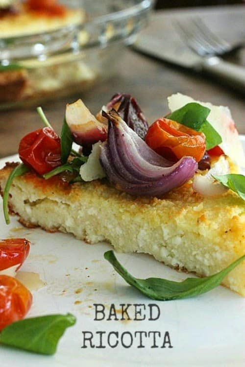 Close up slice of baked Ricotta with Roasted Tomatoes and Onions
