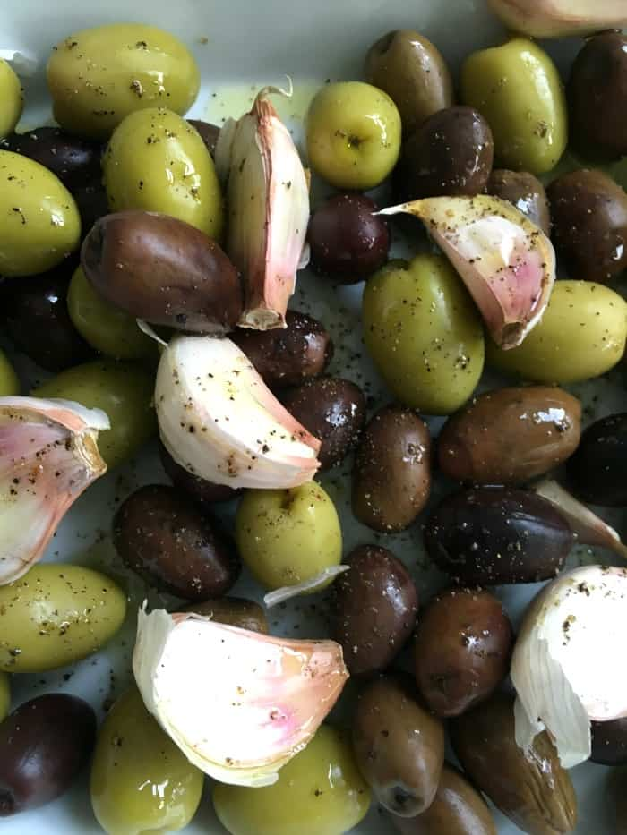 Green and black Olives, Garlic in an oven dish