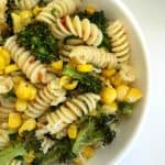 white bowl with broccoli corn harissa pasta bowl