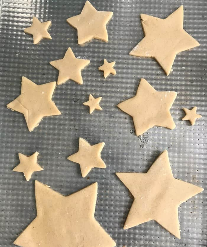 Unbaked Sugar cookies on metal cookie sheet
