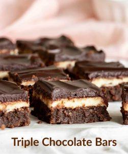 Squares of triple brownie cake, pink cloth