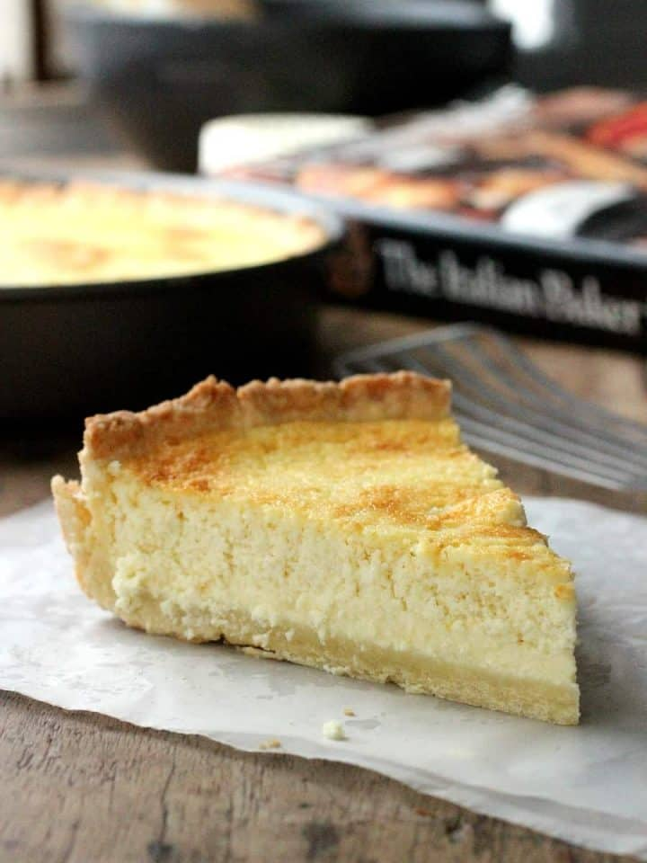 A slice of Lemon ricotta pie with the cookbook