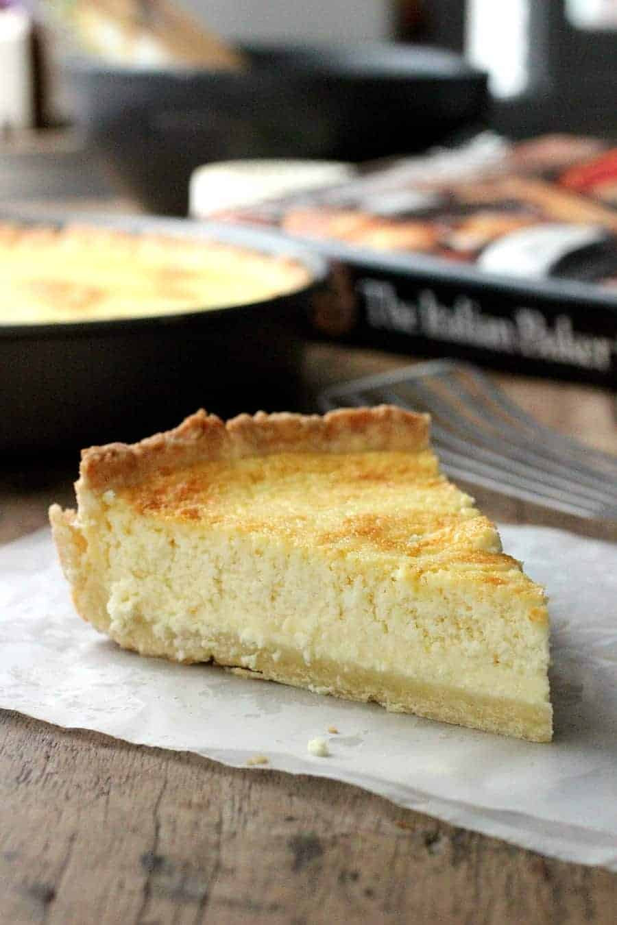 A slice of Lemon ricotta pie and a cookbook