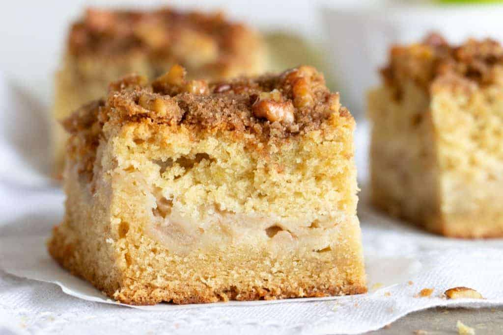Close-up apple crumble coffee cake square on white napkin