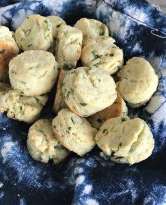 Parmesan green onion scones on blue cloth
