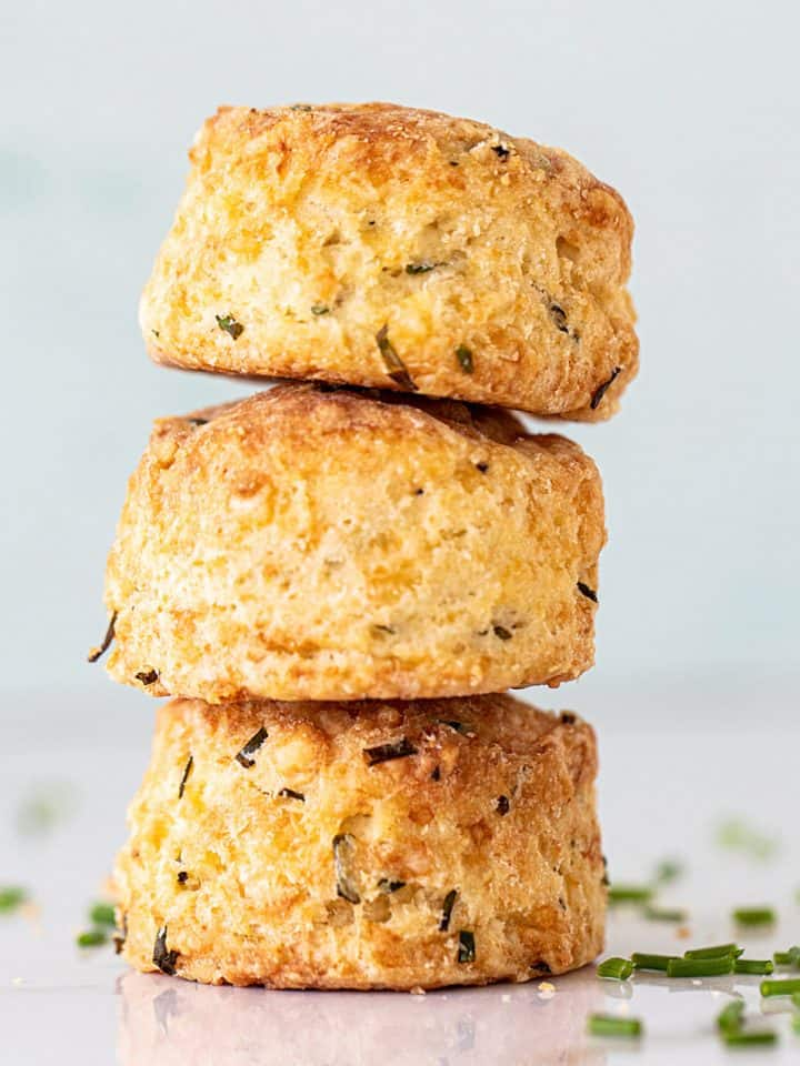 Close up of three scones stacked with a light colored background