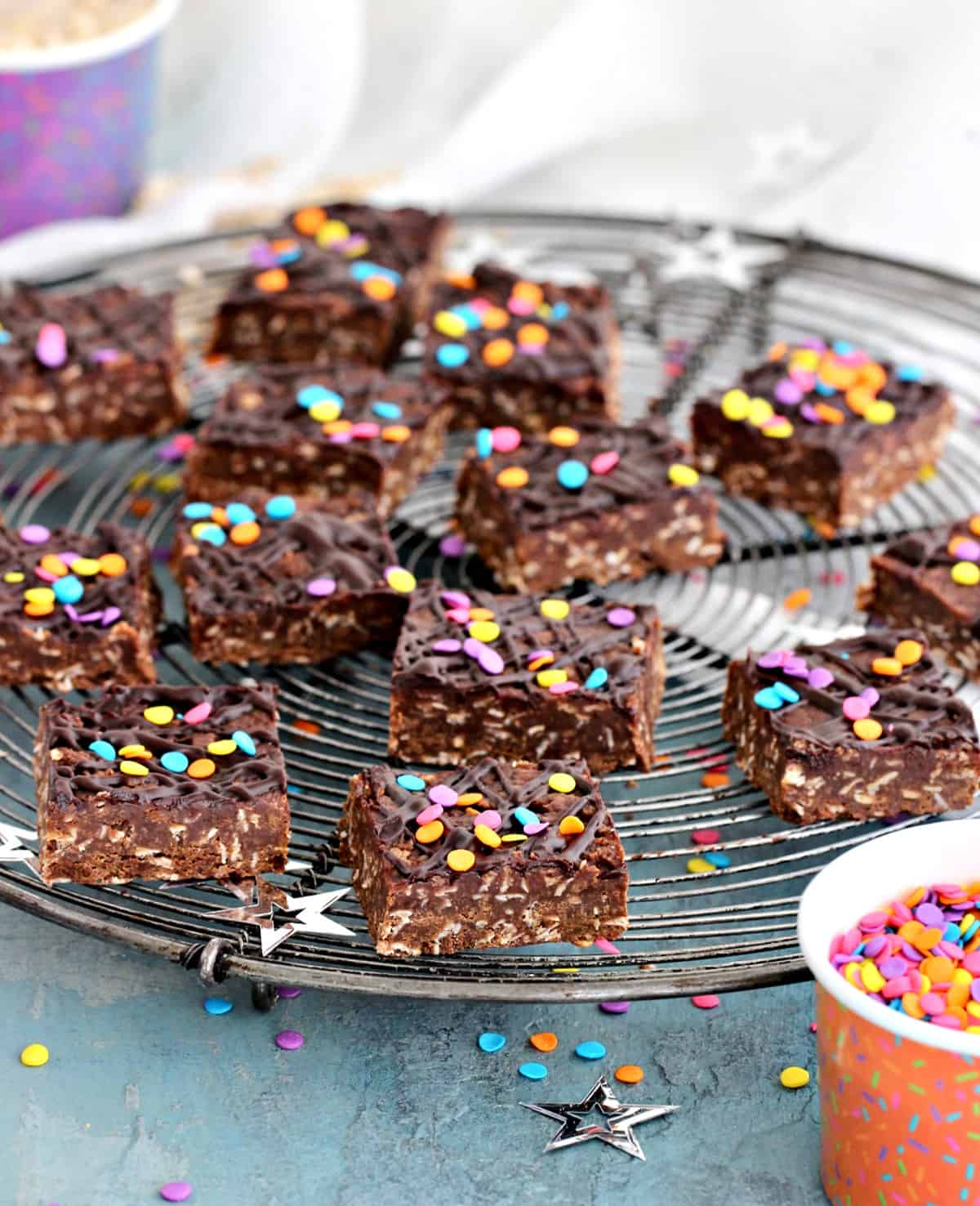 Easy no-bale chocolate oat bars on wire rack, confetti