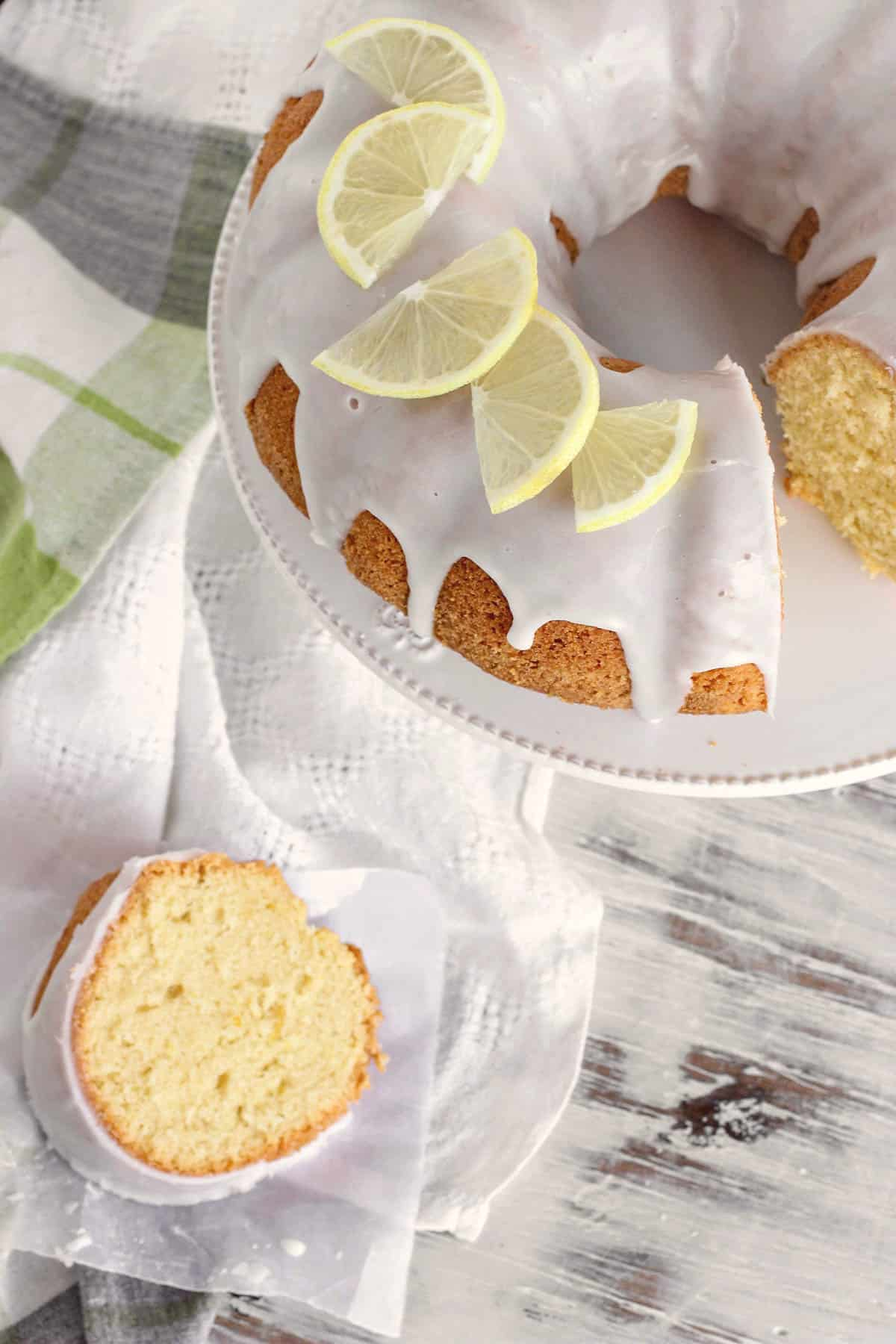Sliced and glazed OLIVE OIL LEMON CAKE with lemon decoration