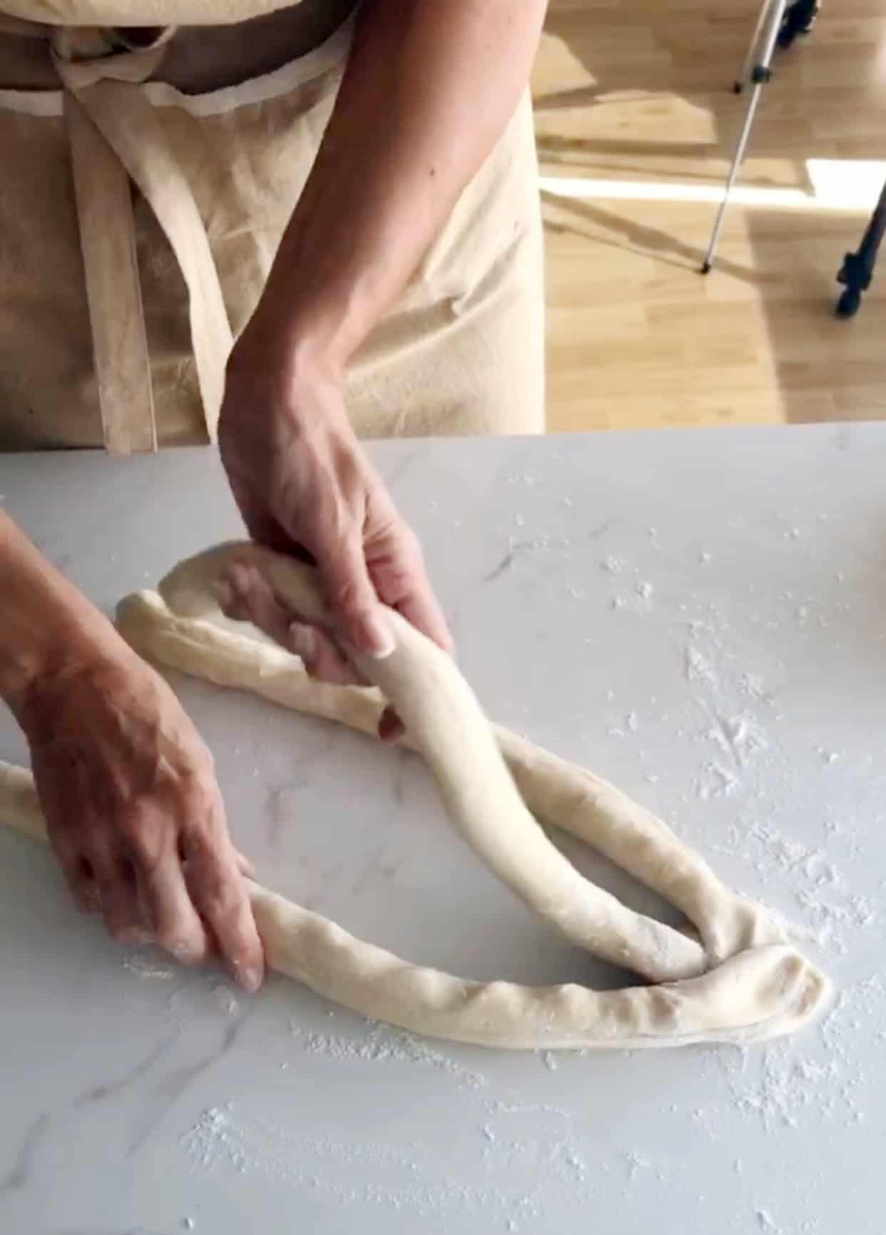 Shaping a braided Easter bread