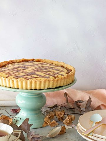 Whole Coconut lemon tart on a cake stand