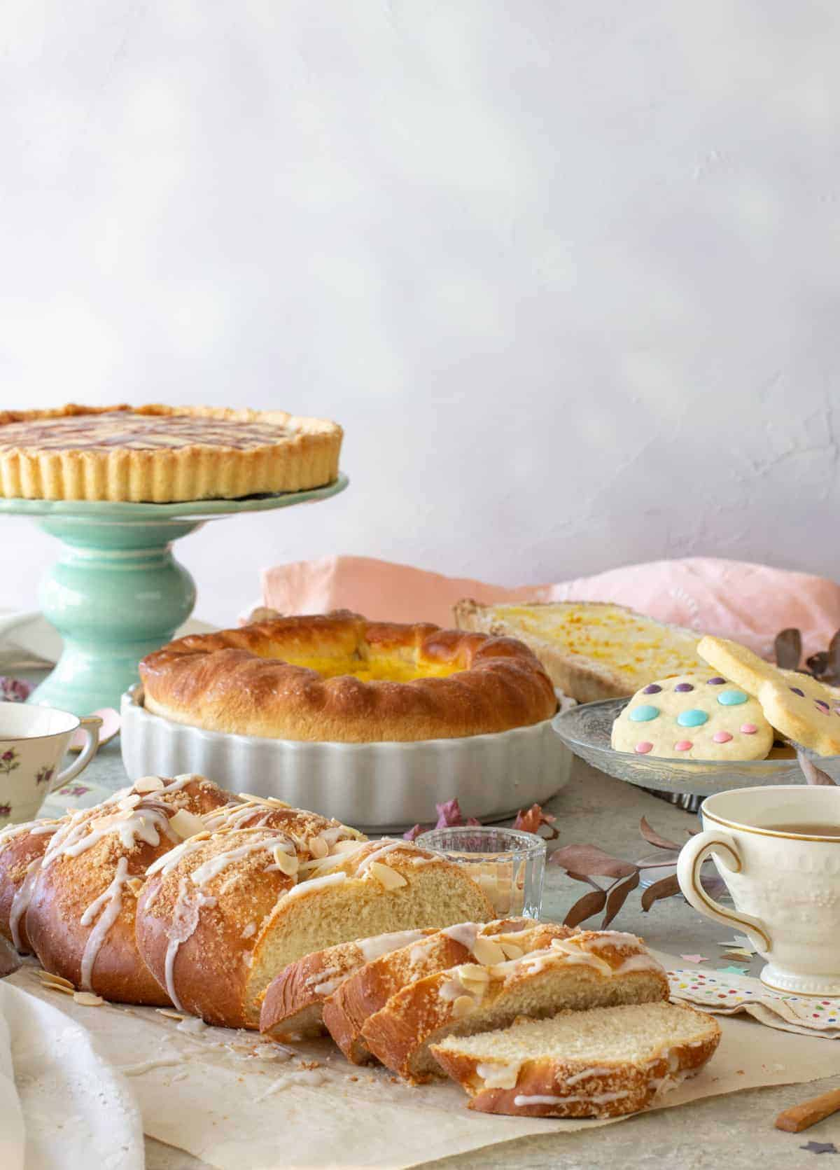 A table with Easter baking recipes, a cup of tea.