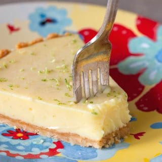 Forked slice of margarita lime pie on a plate