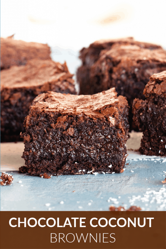 Chocolate coconut brownies on blue surface