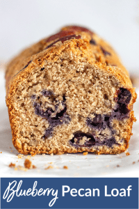 close-up blueberry applesauce loaf cake on white surface