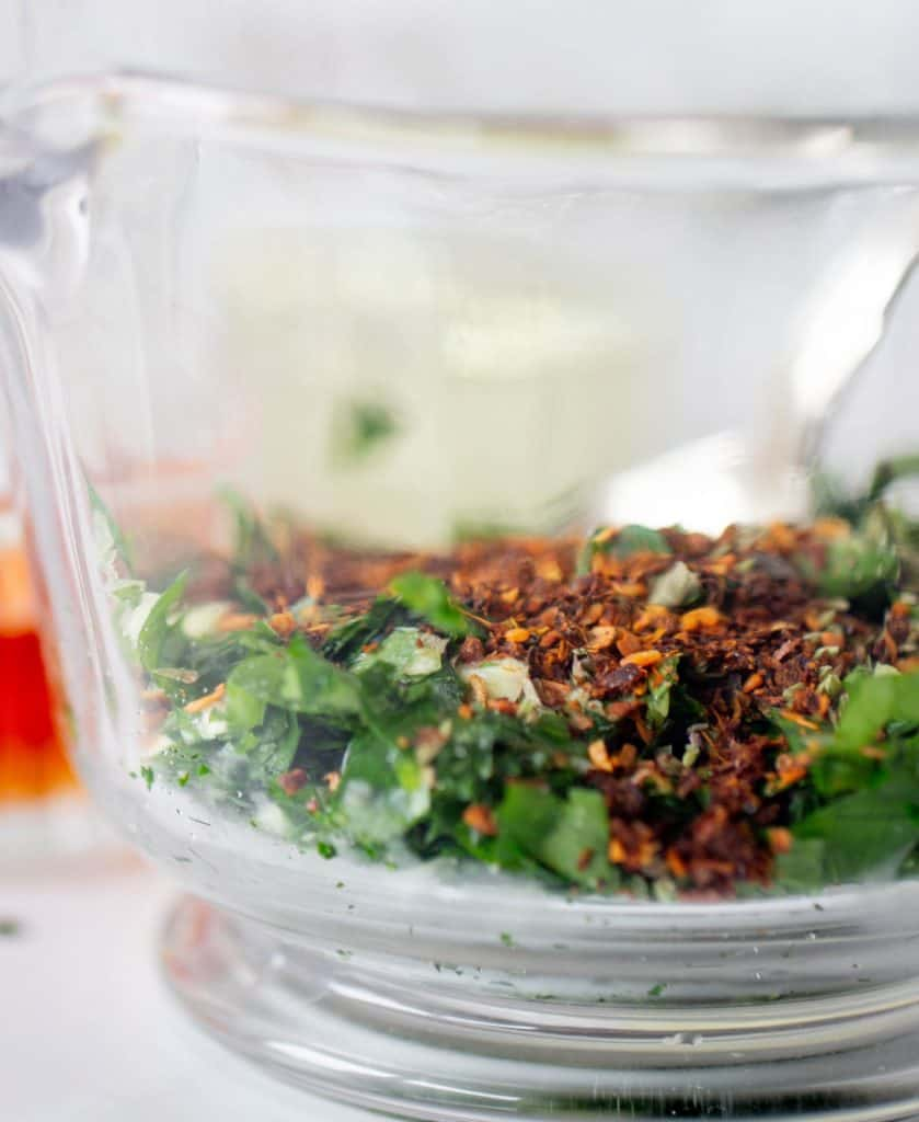 Glass jar with dry chimichurri ingredients