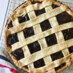 Whole fig lattice tart on wire rack, kitchen towel