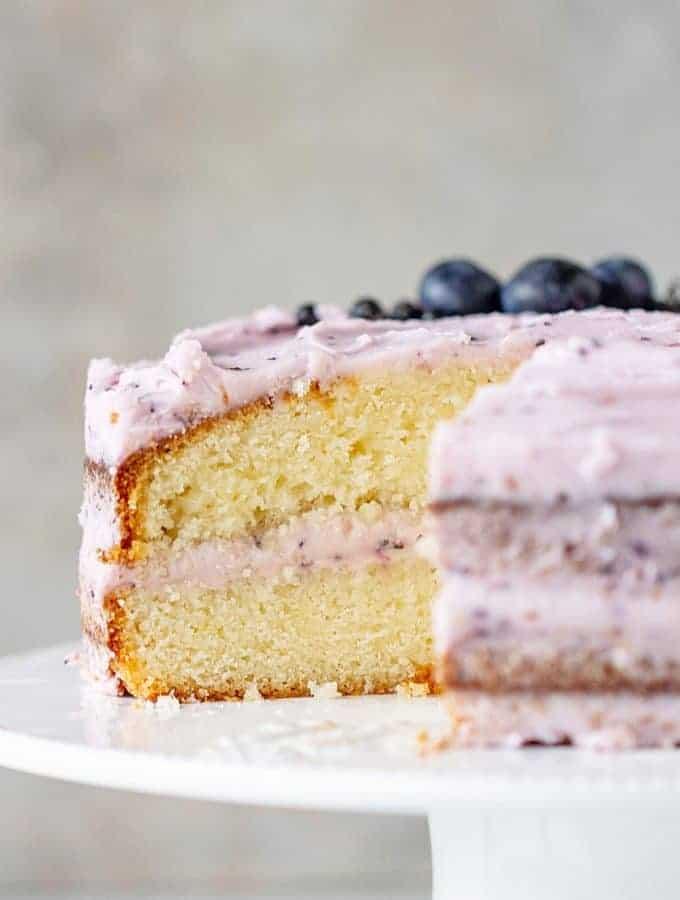 Cut Lemon Blueberry Cake on cake stand