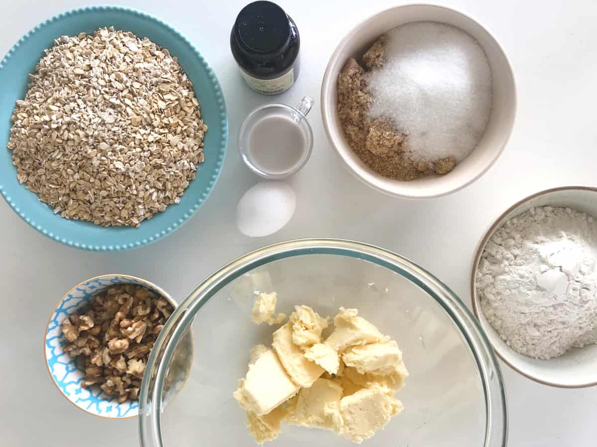Oatmeal Walnut Cookie ingredients in bowls, white table