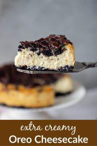 Slice of creamy Oreo Cheesecake on a cake server, cut cake, grey background