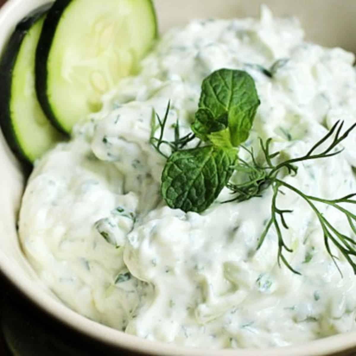 Bowl of cucumber yogurt sauce on bowl