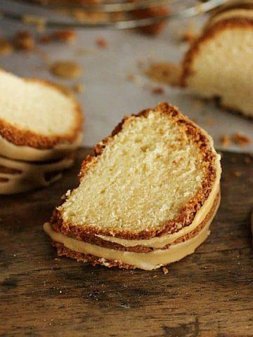Close-up slice of butter bundt cake on wooden table
