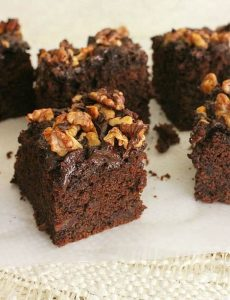 chocolate chip date squares on white surface