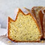 Cut poppy seed bundt cake on white plate