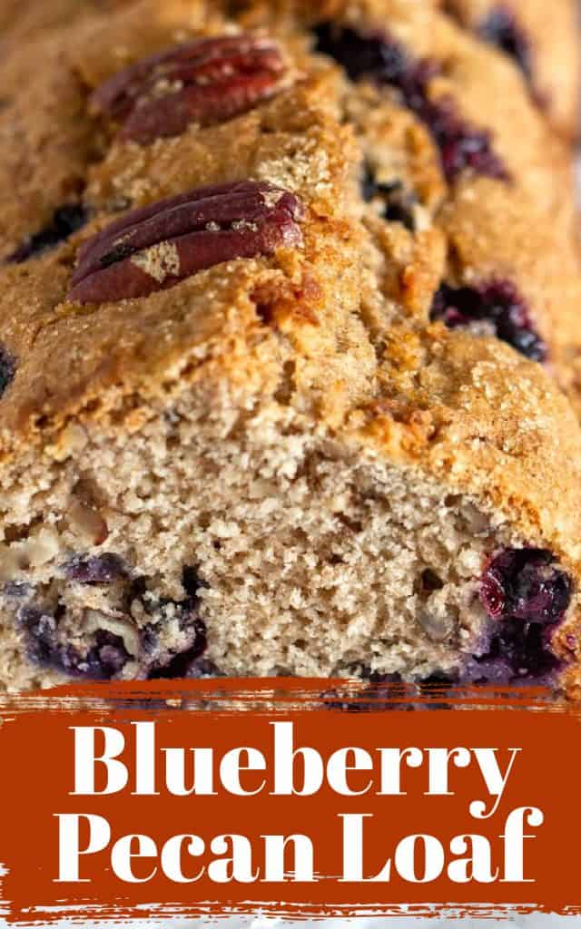 Close-up of quick bread with pecans and blueberries, brown and white text over it